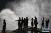 """7月12日,游人在黄河壶口瀑布""""烟从水底升""""景观前游览。"""