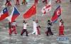 2月25日,中国运动员武大靖手举中国国旗在闭幕式上入场。