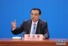 3月20日,国务院总理李克强和副总理韩正、孙春兰、胡春华、刘鹤在北京人民大会堂与中外记者见面,并回答记者提问。 新华社记者 邢广利摄