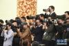3月20日,国务院总理李克强和副总理韩正、孙春兰、胡春华、刘鹤在北京人民大会堂与中外记者见面,并回答记者提问。这是记者在采访拍摄。新华社记者 邢广利 摄