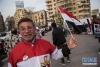 4月2日,在埃及首都开罗,一名支持者参加集会庆祝塞西获得连任。 新华社记者 孟涛 摄