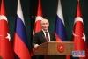 4月3日,在土耳其安卡拉,俄罗斯总统普京出席新闻发布会。新华社发(穆斯塔法·卡亚摄)