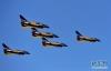 4月15日,空军八一飞行表演队在第三个全民国家安全教育日开放训练中进行歼-10编队飞行。