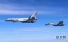 人民空军26日出动轰-6K等多型多架战机,绕飞祖国宝岛,用战机航迹丈量祖国大好河山。 新华社发(翟培松 摄)