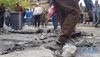 5月9日,人们聚集在叙利亚首都大马士革市北部遭炮弹袭击的迈萨特广场。