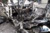 这是5月9日在叙利亚首都大马士革的迈萨特广场拍摄的被毁汽车。
