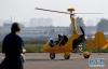 5月24日,航空运动爱好者驾驶飞机降落滑行。 新华社记者李安 摄