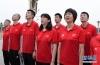 7月4日,中国队总教练郎平(前排右一)在升国旗仪式上。