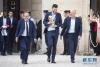 7月16日,法国足协主席勒格拉埃、法国队队长洛里和法国队主教练德尚(从左至右)抵达爱丽舍宫。