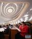 3月5日,第十三届全国人民代表大会第二次会议在北京人民大会堂开幕。这是代表们在认真听会。 新华社记者丁林摄