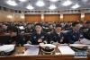 3月5日,第十三届全国人民代表大会第二次会议在北京人民大会堂开幕。这是代表在认真听会。 新华社记者李刚摄