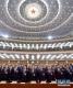 3月5日,第十三届全国人民代表大会第二次会议在北京人民大会堂开幕。这是代表高唱国歌。 新华社记者李涛摄