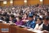3月5日,第十三届全国人民代表大会第二次会议在北京人民大会堂开幕。这是代表在认真听会。 新华社记者丁林摄