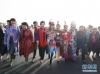 3月5日,第十三届全国人民代表大会第二次会议在北京人民大会堂开幕。这是全国人大代表走向会场。 新华社记者 邢广利 摄