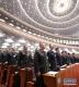 3月5日,第十三届全国人民代表大会第二次会议在北京人民大会堂开幕。这是代表高唱国歌。 新华社记者李刚摄